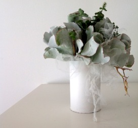 Using mint and succulants, the container is now a little vase that you can use over and over again.